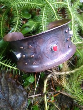 copper cuff and lycopodium moss